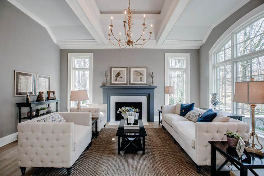 beautiful-living-room-with-white-funriture-gray-paint-fireplace-and-chandelier